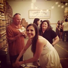 Underhill Rose CD Release Party - Molly Rose Reed of Underhill Rose cutting the cake in the Asheville Distillery Company's barrel room.