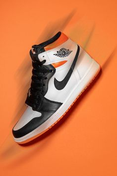 """Even if the Air Jordan 1 High """"Electro Orange"""" isn't branded as such, the colorway, with its black, white, and orange color scheme, is a worthy descendant of the model's beloved """"Shattered Backboard"""" line."""