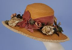 WIDE BRIM STRAW HAT with CLOTH FLOWERS, 1908 - 1910. High crown natural straw with velvet band, cloth roses and other flowers, brim edged in ruched cream net.