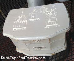 Top of jewelry box. Painted with CeCe Caldwell's Seattle Mist, stenciled in Vintage White. Super easy DIY idea. Thrift store makeover for your home. | DuctTapeAndDenim.com