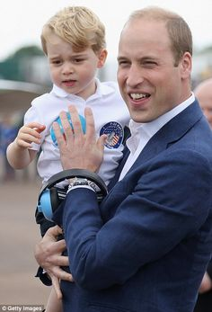 July 8, 2016: The Duke and Duchess of Cambridge, along with 2-year old Prince George, attended the Royal International Air Tattoo air show at RAF Fairford, the largest event of its kind in the world. Prince William scooped the two-year-old up in his arms.