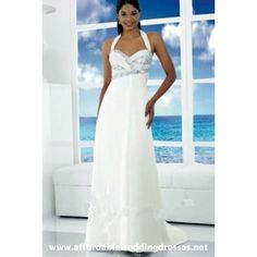 This stunning white chiffon floor length wedding dress is decorated with a number of elegant and eye catching features, so it's no wonder that this is a popular choice with modern brides. One of the most unusual and interesting features is the halter neck style straps that secure the dress. The two straps are almost as long as the dress itself, creating a nice addition to the train of the dress.