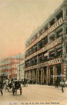 1920's Hong Kong Des Voeux Road The Sun Co. & Tram Hand-tint Postcard.