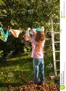 Girl Hanging Clothes On Clothesline At Garden Stock Photo - Image ...