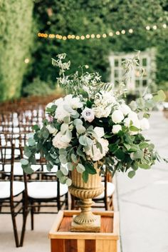 Neutral wedding ceremony decor.  Ivory, roses, eucalyptus, and greenery.