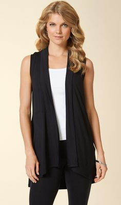 Soma Sleeveless Cover Up in Black. Lovely in layers— add a touch of warmth and a whole lot of softness with this modern, sleeveless cover up with soft elastic at waist.
