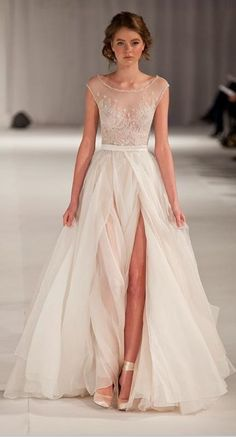 Not exactly what I want, but the sheer look is beautiful.  too sheer for me though. no boobies at the wedding #weddingdress