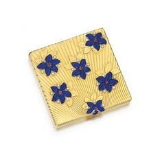 Enamel, ruby and diamond compact, Bulgari, circa 1945 Decorated with a sunburst reeded pattern enhanced with blue enamel flowers set with circular-cut rubies and diamonds, thumbpiece set with calibré-cut rubies, signed Bulgari, Italian maker's mark.