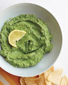 Guacamole Hummus - 1 can (15.5 ounces) chickpeas, rinsed and drained   3 cups fresh cilantro leaves   1 garlic clove, chopped   1 ripe avocado, roughly chopped   3 tablespoons extra-virgin olive oil   1 teaspoon fresh lemon juice   Coarse salt and ground pepper   Lemon wedges <-- I might actually eat this.