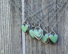 This turquoise heart necklace has a really cute small turquoise heart stone. Each one is unique. Ive set it in a sterling setting and then given it an antiqued silver finish. This gives it a little rustic look. The turquoise heart measures 10mm (just under 1/2 inch) wide and tall. The chain is a lovely light 18 inch sterling silver chain. Each turquoise heart stone is unique and one of a kind so please choose one each of the letter of the heart you want.   International buyers please see my…