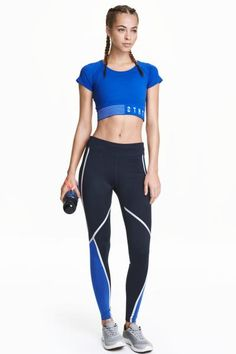 Sports tights: Sports tights in fast-drying functional fabric with wide ribbing at the waist, taped seams and a concealed mesh key pocket in the waistband.