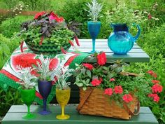 When you're not using your picnic table, dress it up with a display of picnic-themed planters, such as plastic pitchers and glasses, colorful serving bowls and, of course, an old picnic basket.