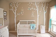 I absolutely love this tan and white nursery and how adorable is the tree wall art!!!