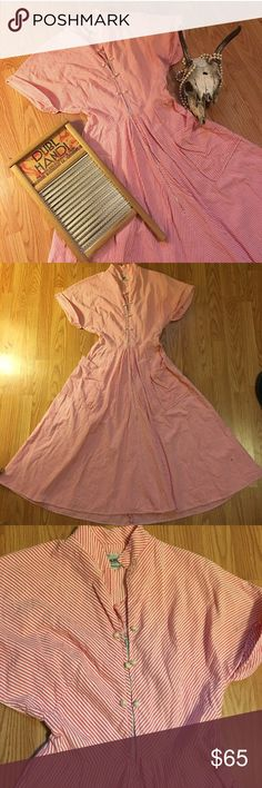 💕1940s Day Dress💕 Amazing vintage piece from the 1940s/50s. Pink and white candy stripe, with a fit and flare cut. Zips up front from waist, with decorative pearl button detailing on bust. Has pockets! 😍 In good vintage condition for a piece of this age. Slight fraying at sleeves, and has belt loops but is missing belt. Has two holes at neck, which I think might be for fastening with a pin. Totally wearable as is. ((TAGS: 40s, 50s, pinup, retro, rockabilly, Hell Bunny, Stop Staring…
