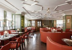 In London, Martin Brudnizki Design Studio led the renovation of 45 Jermyn St., a restaurant located within the historic Fortnum & Mason department store. The design features a traditional oak parquet flooring, bespoke rosewood tables and an Edwardian-inspired patterned bead on the ceiling. The burnt orange seating was inspired by the store's 1930s catalog illustrations by artist Edward Bawden.