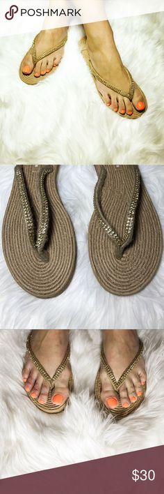"Gold Rhinestone Thong Flip Flop Sandals These flip flops are uniquely stylish and offer your feet unbelievable comfort. They will be your go-to shoes for everyday wear. Product Features: 1/2"" Heeled Flip Flops with Rubber Sole 1/4"" Padded Insole with Braided Hemp. Look Soft and Comfortable Braided Wicker Straps with Rhinestones adornments Lightweight for durability Man-made Materials Medium Width. Boutique Shoes Sandals"