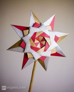 Find out how to fold a fantastic origami star for Christmas - Braided Corona Star designed by Maria Sinayskaya. Video tutorial by Sara Adams. Diy Origami, Origami Modular, Origami And Kirigami, Origami Paper Art, Origami Folding, Origami Stars, Origami Tutorial, Paper Folding, Diy Paper