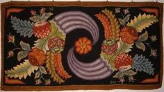 Beautiful primitive hooked rug...gorgeous colors & placement!