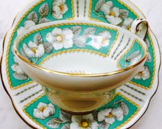 EB Foley Christmas Rose Turquoise Tulip Shape Tea Cup and Saucer
