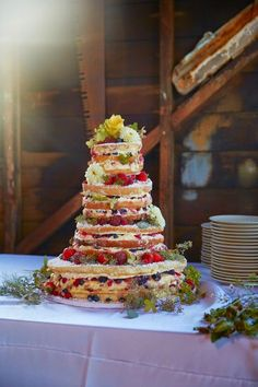 This Is The Most Dreamy Boathouse Wedding You've Ever Seen #refinery29  http://www.refinery29.com/inverness-wedding#slide-5  So fresh! This tiered, naked cake was made by the bride's mother. McAuliffe spent tons of time in her mom's bakery growing up, so she knew she wanted to have her mom whip up the cake for the big day.