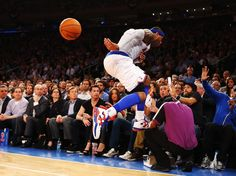 33. Carmelo Anthony sails into the crowd while chasing a loose ball for the New York Knicks during a May 1 playoff game.