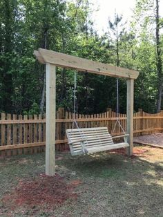 My husband really wanted a swing for us to use while the kids ran outside. So, I caved and told him to go for it! He's a contractor, so he definitely has a lot… Backyard Swings, Pergola Swing, Backyard Patio, Backyard Landscaping, Garden Swings, Outdoor Bench Swing, Lawn Swing, Outdoor Swings, Porch Swing Frame