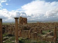 Timgad is located in Algeria and was founded around 100 AD. The ruins give insight into Roman cities and the streets follow a perfect grid, as used in Roman city planning. If you visit the site today, you can see the arch of Trajan, the baths and the temple of Jupiter, which is as large as the pantheon in Rome.
