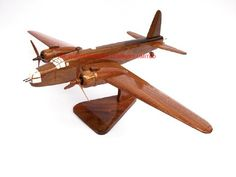 "A beautiful hand carved desktop model of the Wellington Bomber. The model has been carved from solid mahogany. The model comes boxed and is simple to assemble. The wings, tail fins, stand and rotas simply slot into pre-drilled holes on the body of the aircraft. No glue required. Size H 8"", L 15"", W 18"". Visit our website at http://www.thewoodenmodelcompany.co.uk to view the full range of our models."