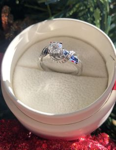 Solitaire diamond ring with blue sapphire and diamond overpass shank. Diamond Solitaire Rings, Shank, Blue Sapphire, Engagement Rings, Jewelry, Rings For Engagement, Wedding Rings, Jewlery, Jewels