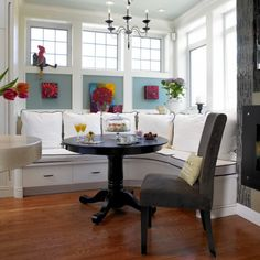built-in banquette, windows, the color blue and art on with it. dark furniture and i love enameled millwork. i am posting another shot that shows more of the kitchen