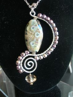 Wirework Pendant by Gretchen Schueller of Piece of Mind, awesome Lampwork bead by Lisa Fletcher.