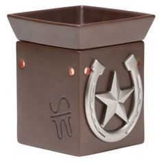 Wrangler Scentsy Warmer PREMIUM  The look of branded, hand-stitched leather and polished western hardware make Wrangler the perfect choice for the cowboy — or devout Western movie fan — in your life. Pair with Weathered Leather for that horse lover tack room feel! www.CarleyFruish.scentsy.us