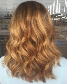 Wavy Strawberry blonde hair with some blonde Balayage highlights. Hair done by Mindy Hardy, Heath Salon and Spa, Heath Texas, 972-771-0688