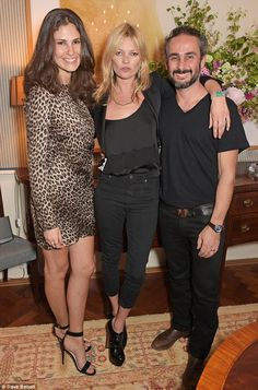 The main man: Kate cuddles the jewelllery designer Ava Vartanian at the preview of his new...