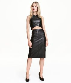 Check this out! Fitted skirt in soft, stretch imitation leather with a concealed zip at side, slit at back, and raw-edge hem. Lined. - Visit hm.com to see more.