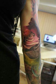 Cupcake tattoo on arm