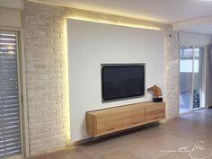 Tv wall , combined with gypsum , bricks  & hidden lighting /  קיר טלויזיה בשילוב של גבס,בריקים ותאורה נסתרת