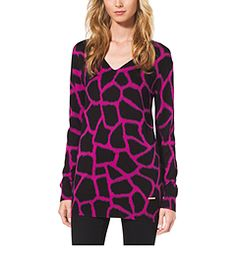 Safari goes sophisticated with this graphic sweater. Designed in a bold giraffe print, its V-neck silhouette is cut from a soft cotton-blend. Team it with second-skin leggings and leather knee boots for a wildly attractive, go-anywhere look.