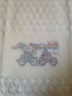This towel is too cool! I really loved making it. Its from the 1987 Leisure Arts Leaflet 560 Towels For Good Sports. Everything is hand stitched, by me. The towel was purchased from a craft supply store.  The back is finished with an iron-on stabilizer to protect the back and to prevent unraveling. Also, it just makes things look nicer. The cross stitching is on the middle panel only.  This would be a perfect bathroom hand towel for anyone in your life who loves to ride their bike and…