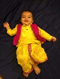 Toddler in yellow dhoti