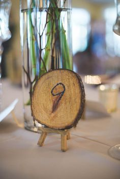Rustic Wood Slice Table Number - Plum and White Persian Wedding at the Lange Farm - Photo by Napoleoni Photography - click pin for more - www.orangeblossombride.com