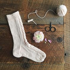 Simple lace and delicate colour make for beautiful socks that are calming to knit and cosy to wear in the early morning light.