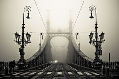 I like cities in fog, because even close things melt away into the distance.