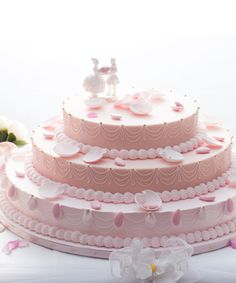 This Wedding Cake by Laduree is the prettiest one I've ever seen --- and I'm not even a girly-girl. I would love to fly to Paris just too see this cake, let alone taste it!