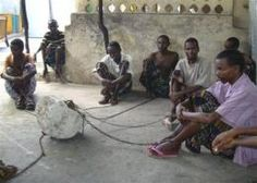 In this photo of Wednesday April 28, 2011, chained mentally ill patients sit within Ahlu Khayr mental health center in Mogaidshu, Somalia.