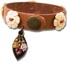The Boston Bracelet uses Buttons as elements to adorn a leather bracelet cuff.