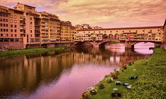 View of Ponte Vecchio on a beautiful afternoon in Florence. Prints available! Just click through the image, customize your purchase, and receive it in your home, ready to hang! :) #florence #italy #europe #travel #photography #travelphotography #print #artwork #destination #magic #beautiful #fotografia #italia #europa #viajes #color #colorful #vibrant #sky #architecture #scenic #scenery #trip #reflection #water #building #pontevecchio