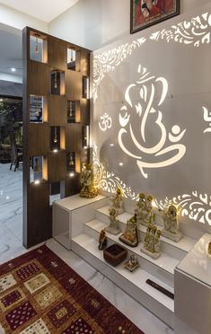 Pooja This Puja space designed inside the modern living room gives it a spiritual ambience allowing a continuous cycle of energy flow throughout the house. Sky Box House designed by Garg Architects Pooja Room Design, Temple Design For Home, Living Room Modern, Box Houses, House Interior, Room Door Design, Living Room Partition Design, House Interior Decor, Pooja Room Door Design