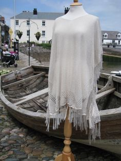Metallic knit poncho £49