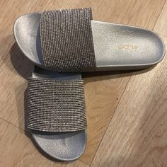 Shop Women's Silver size 5 Sandals at a discounted price at Poshmark. Description: NWOT Aldo slip on sparkly silver sandals Made in Brazil. Sparkly Sandals, Silver Sandals, Women's Shoes Sandals, Glitter Slides, Aldo, Slip On, Ih, Color, Things To Sell